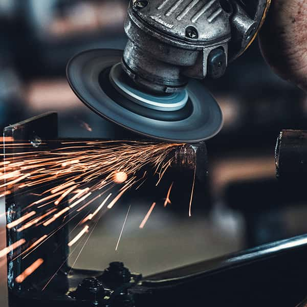 Metal grinding wheel with sparks, Kiefer Likens on Unsplash